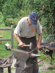 Westport blacksmith Tony Millham demos his trade at the Handy House in 2012.
