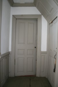 First floor, lobby entry. Six panel door.