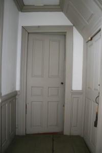First floor, lobby entry. Six panel door.