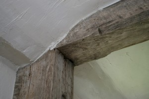 Room 101, Hall Chamber. Detail of post head and summer beam.