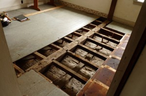 Room 202. The smoke stained floor joists are Period 1 material.