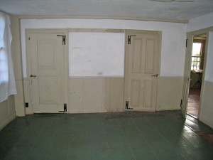 Room 102, Old Kitchen. The one over-one- panel door on the left is believed to date to the Period 1 house and has been retained in its original location.
