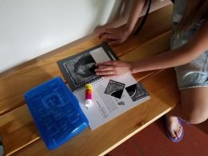 Girl making puzzle closeup